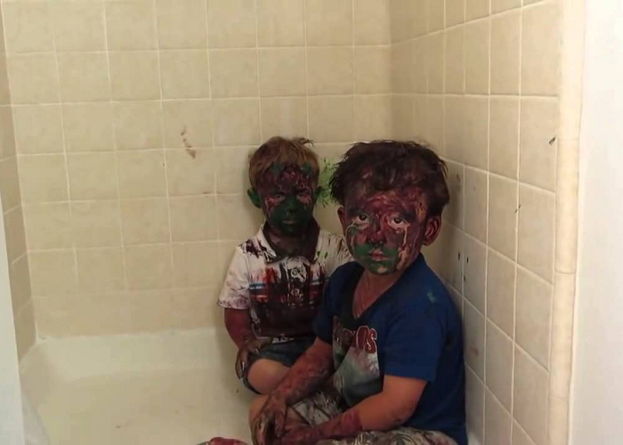 Watch These Kids Play With Paint And Get It All Over Their Faces