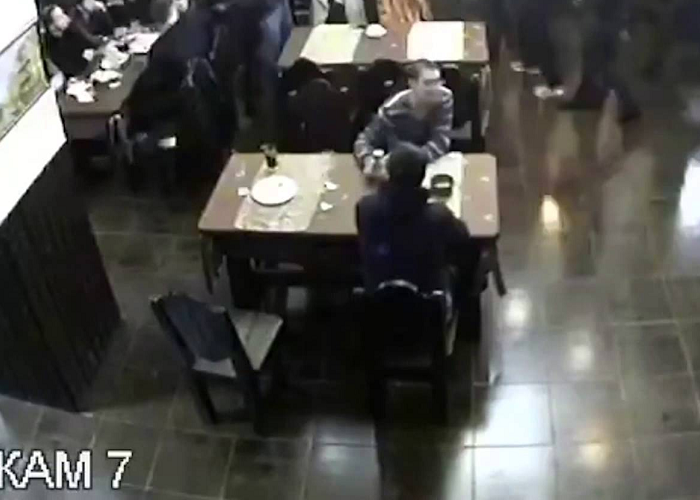 The Guy Remains Calmly Seated In The Middle Of A Restaurant Fight