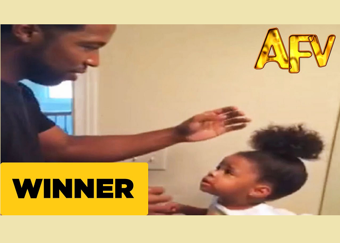 This Little Girl's Hair Is Just Too Strong For Dad's Best Efforts