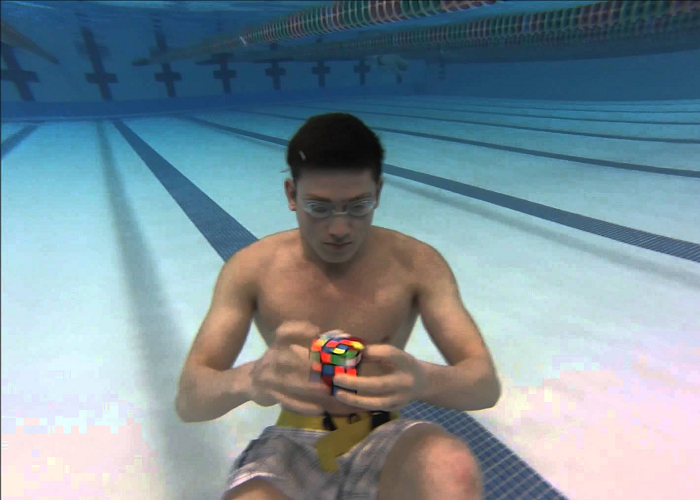 Look At This Guy Solving 3 Rubik's Cubes Underwater