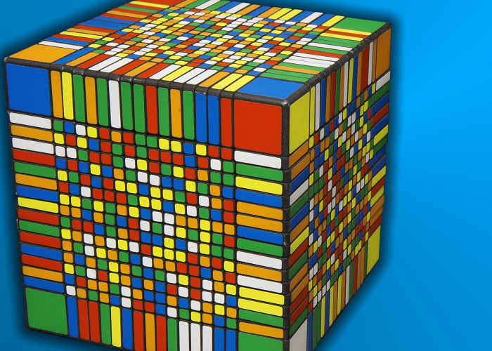 Watch This Guy As He Solves The World's Largest Rubik's Cube Under 8 Hours