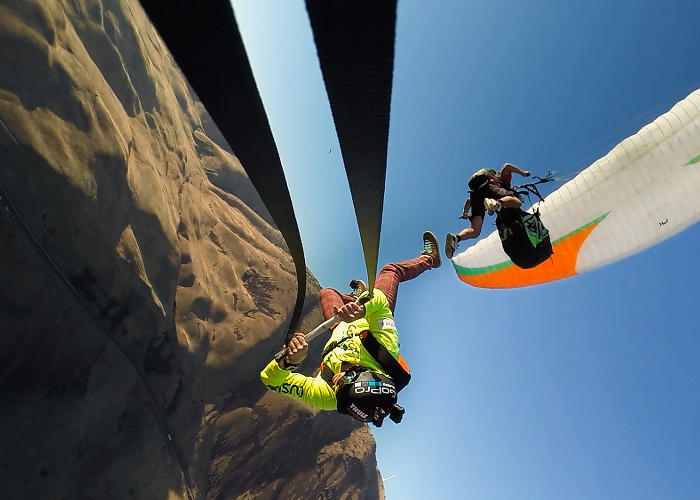 Watch These Guys Rope Swinging From A Paraglide