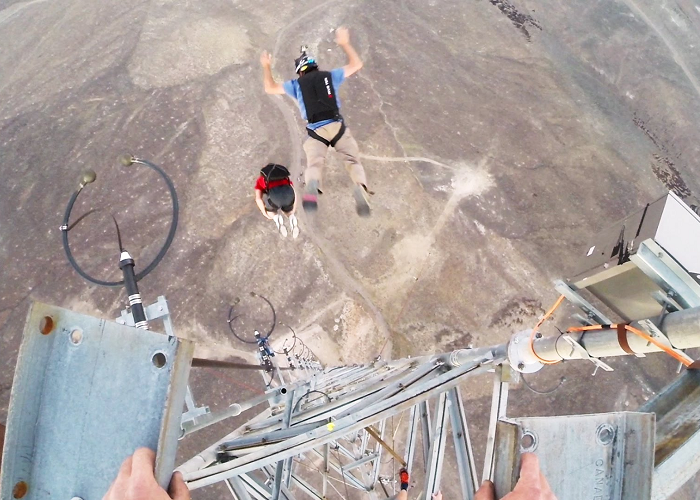 Watch These Guys Base Jumping With 9 Front Flips Off A Tower