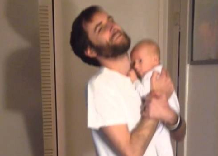Watch This Guy As He Wears Pants With A Baby In Hand